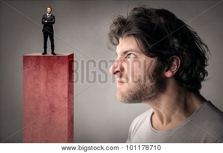 Envious man looking at a manager