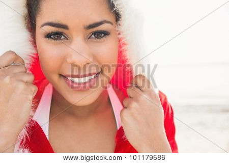 Attractive woman wearing a christmas styled jumper at the beach