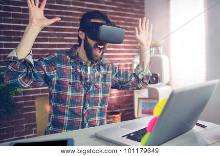 Surprised creative businessman wearing 3D video glasses while working in office
