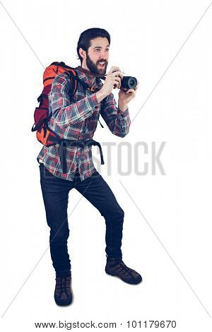 Excited photographer talking picture through camera