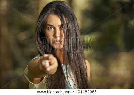 Closeup portrait of young angry woman pointing at someone as if to say you did something wrong,