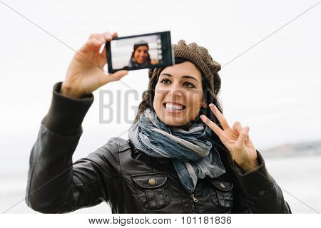 Casual Woman Taking Selfie Photo With Smartphone