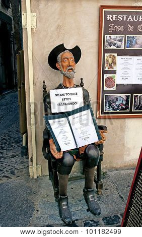 Sculpture Of Don Quixote Keeps The Menu In Front Of The Restaurant