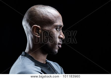 Profile view of rugby player against black background