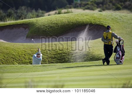 GLENEAGLES SCOTLAND, 29 AUGUST 2009. Colin Montgomerie (GBR) playing a shot from a bunker on the 8th during the third round of the European Tour Johnnie Walker Championship.