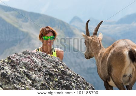 Woman In Mountain Meets Ibex