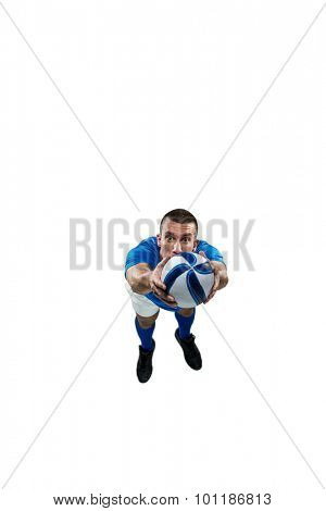 Portrait full length of American football player diving in mid-air against white background