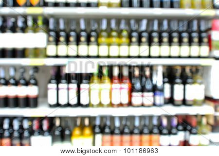Abstract Blur Or Defocus Background Of Bottles Of Wine On Shelf In Supermarket