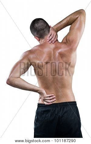Rear view of shirtless athlete with neck pain over white background