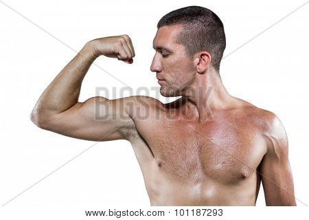 Confident shirtless athlete flexing muscles against white background