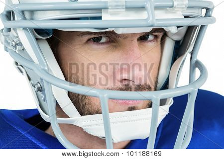 Close-up portrait of stern American football player against white background