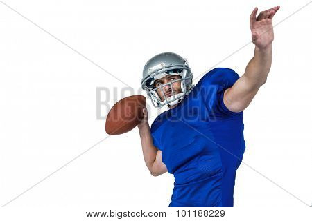 American football player looking away while throwing the ball on white background