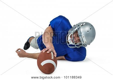 Full length of American football player struggling to catch the ball against white background
