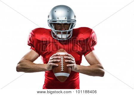 Portrait of American football player in red jersey and helmet holding ball on white background