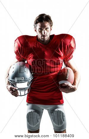 Portrait of an American football player in red jersey holding helmet and ball on white background