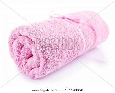 Rolled up colorful towel isolated on white