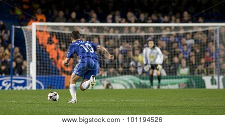 LONDON, ENGLAND. 08 December 2009. - Joe Cole playing for Chelsea running toward the Apoel goal during the Uefa Champions League match, between Chelsea and Apoel Nicosia at Stamford Bridge.