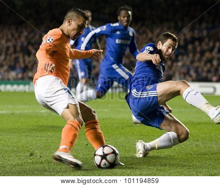 LONDON, ENGLAND. 08 December 2009. - Constantinos Charalambides playing for APOEL FC  attempts a cross as Joe Cole playing for Chelsea trys to block  during the Uefa Champions League match