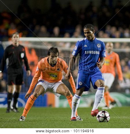 LONDON, ENGLAND. 08 December 2009. - Florent Malouda playing for Chelsea  shields the ball during the  Uefa Champions League match, Group D, Chelsea v Apoel Nicosia at Stamford Bridge, London, UK.