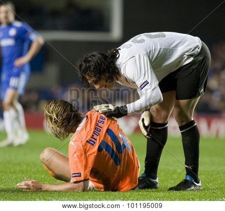 LONDON, ENGLAND. 08 December 2009. - Joost Broerse playing for APOEL FC gets help from Dionisis Chiotis during the Uefa Champions League match, between Chelsea and Apoel Nicosia at Stamford Bridge.