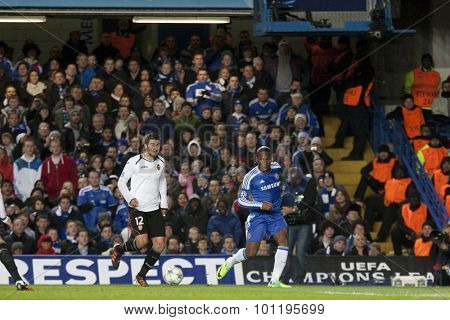 LONDON, ENGLAND. 06 DECEMBER 2011. Valencia's Spanish defender Antonio  and Chelsea's forward Didier Drogba in action during the UEFA Champions League match between Chelsea and Valencia from Spain