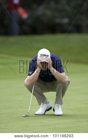 WENTWORTH, ENGLAND. 23 MAY 2009.Ross Fisher (GBR) lines up a putt  playing in the 3rd round of the European Tour BMW PGA Championship.