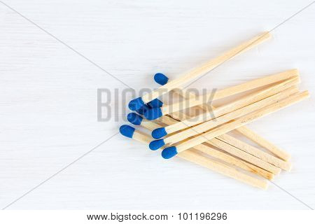 Matches On White Wooden Background