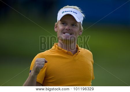 WENTWORTH, ENGLAND. 23 MAY 2009.S���¿ren KJELDSEN DEN punches the air in delight after finishing the day in 2nd place playing in the 3rd round of the European Tour BMW PGA Championship.