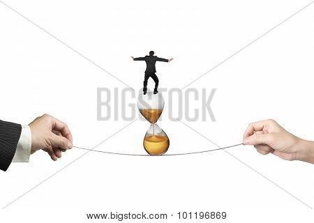 Two Hands Pulling Rope Businessman Balancing On Hourglass