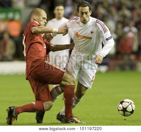 LIVERPOOL ENGLAND. 16 SEPTEMBER 2009. Martin Skrtel playing for Liverpool tackles Leandro playing for Debreceni VSC  in the Champions League Group E, match between Liverpool FC and Debreceni VSC