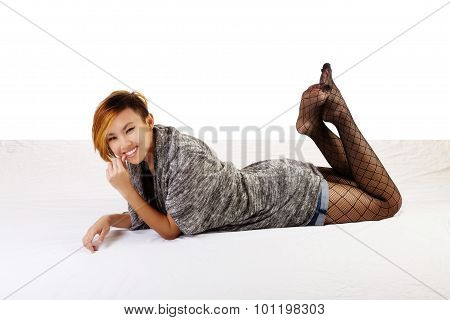 Smiling Asian American Woman Reclining Fishnet Stockings