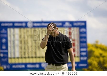 PARIS FRANCE, 04 JULY 2009. Martin Kaymer (GER) puts his head in his hand after missing a birdie putt on the 18th competing in the 3rd round of the PGA European Tour Open de France golf tournament.