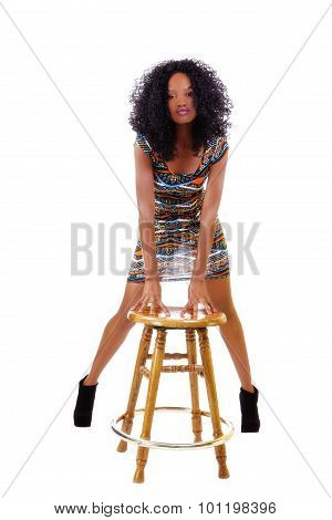 Skinny African American Woman Standing Behind Wooden Stool