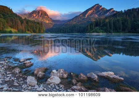 Amazing summer morning on the fantastic Swiss lake Obersee, located near Nafels village. Alps, Switzerland, Europe.