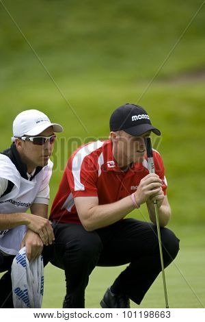 WENTWORTH, ENGLAND. 22 MAY 2009.David Horsey (GBR) and his caddy discuus a putt on the 2nd hole playing in the 2nd round of the European Tour BMW PGA Championship.