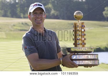 KENT ENGLAND, 31 MAY 2009.  Christian CEVAER (FRA) with trophy winner of the European Tour European Open golf tournament.