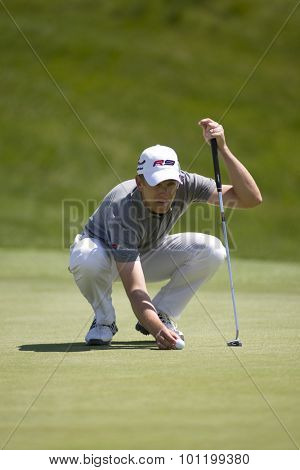 KENT ENGLAND, 31 MAY 2009. Christian CEVAER (FRA) places his ball on the 1st green playing in the final round of the European Tour European Open golf tournament.