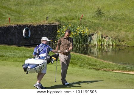 KENT ENGLAND, 31 MAY 2009. Mark FOSTER (GBR) hand his ball to his caddy for cleaning playing in the final round of the European Tour European Open golf tournament.
