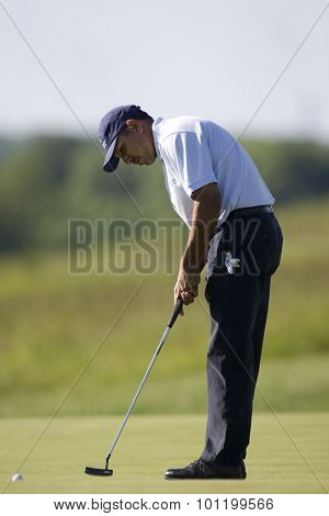 KENT ENGLAND, 30 MAY 2009. Jeev Milkha SINGH (IND) putting on the 18th green playing in the third round of the European Tour European Open golf tournament.