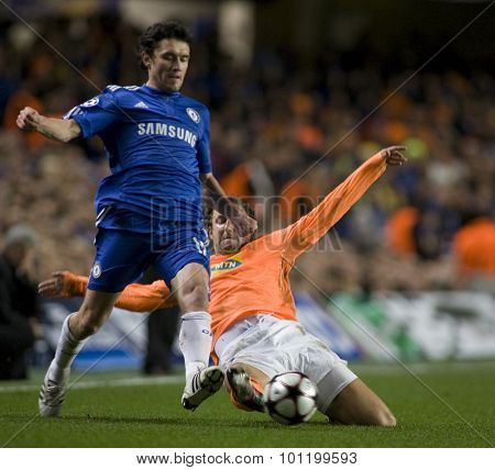 LONDON, ENGLAND. 08 December 2009. - Yury Zhirkov playing for Chelsea evades a tackle from Kamil Kosowski playing for APOEL FC during the Uefa Champions League match