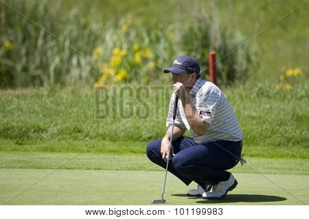 KENT ENGLAND, 29 MAY 2009. Ben CURTIS (USA) lines up a putt on the 3rd green playing in the second round of the European Tour European Open golf tournament.