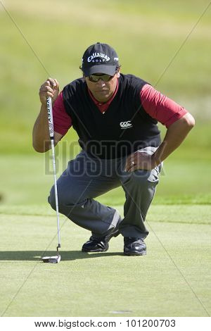 KENT ENGLAND, 27 MAY 2009. Michael CAMPBELL (NZL) lines up a putt playing in the first round of the European Tour European Open golf tournament.
