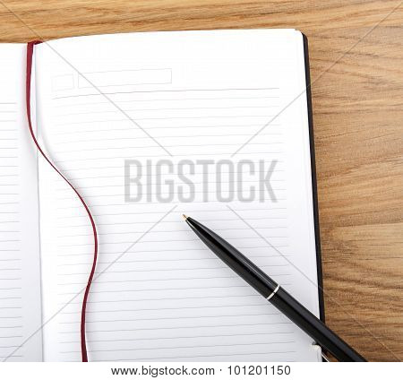 Open Blank Book With Lines, Red Bookmark, Black Cover And Pen.