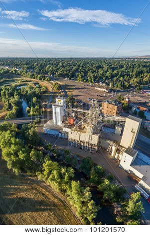 FORT COLLINS, CO, USA - September 4,  2015: Aerial view of industrial landmarks on Poudre River - Harmony Mill and Ranch-Way Feeds grain elevators the oldest continuously running business in town.