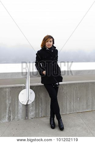 Asian American Woman Outdoors In Jacket And Pants