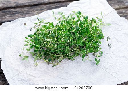 Fresh Green Vegetables Bunch Of Thyme On Crumpled Paper And Old Wooden Table.
