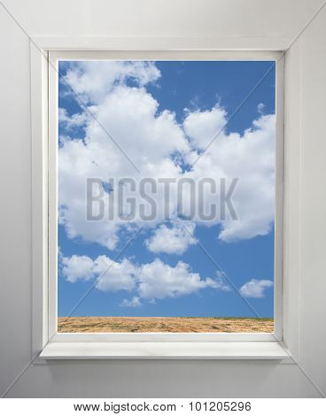 Modern residential window with a view of clouds and field