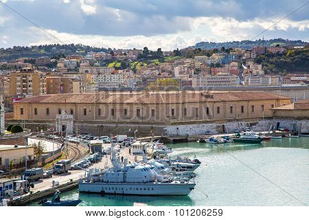 The harbor of Ancona with the boats docked and city panorama