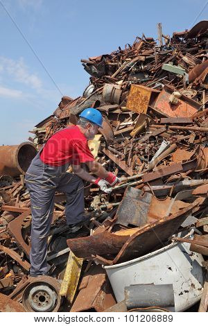 Recycling Industry, Worker At Heap Of Old Metal