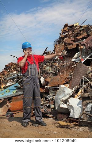Recycling Industry, Worker And Heap Of Old Metal